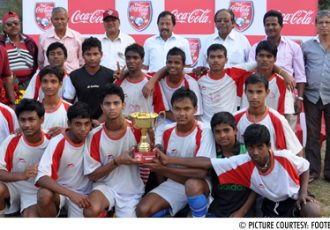 Raghunath Jew High School with the Coca-Cola Inter School Football Tournament trophy
