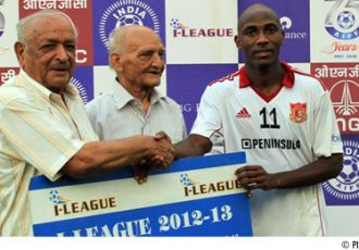 Pune FC midfielder Douhou Pierre receives the Man of the Match award