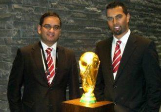Arunava Chaudhuri and Chris Punnakkattu Daniel with the FIFA World Cup Trophy