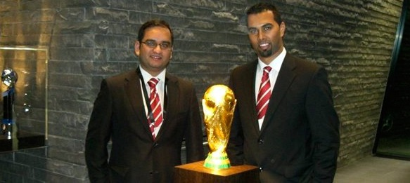 Arunava Chaudhuri and Chris Punnakkattu Daniel with the FIFA World Cup Trophy