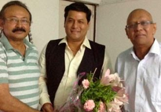 Ankur Datta and Kushal Das with Sarbananda Sonowal (centre)