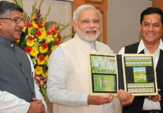 Prime Minister of India Narendra Modi releases commemorative postage stamps on the 2014 FIFA World Cup
