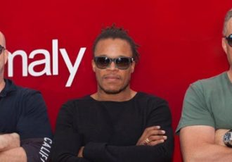 Anomaly founding partners Mike Byrne and Richard Mulder with Edgar Davids