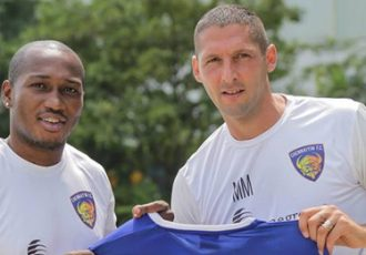 Eric Djemba Djemba and Marco Materazzi