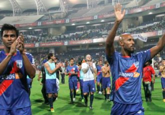 Mumbai City FC's Abhishek Yadav and Nicolas Anelka