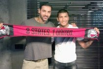 John Abraham and Nirmal Chettri pose with a NorthEast United scarf.