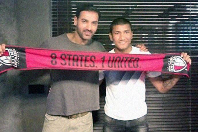 John Abraham and Nirmal Chettri pose with a NorthEast United scarf.