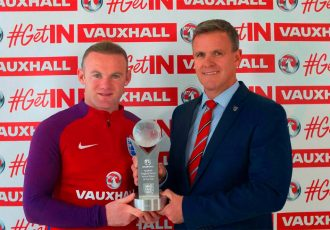 Wayne Rooney receives his Vauxhall England Player of the Year award from Vauxhall Head of Sponsorship and Events Andrew Curley.