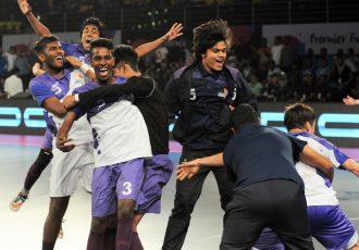 Players of the Kochi 5s celebrating in the Premier Futsal league.