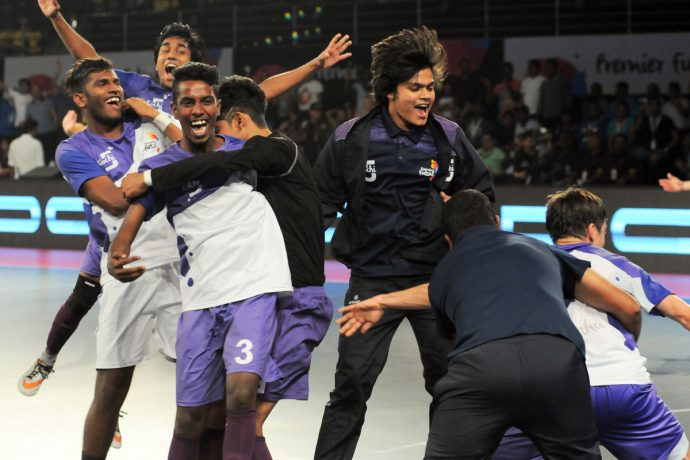 Players of the Kochi 5s celebrating in the Premier Futsal league.