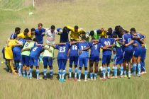 Mohammedan Sporting Club players and officials during a huddle.