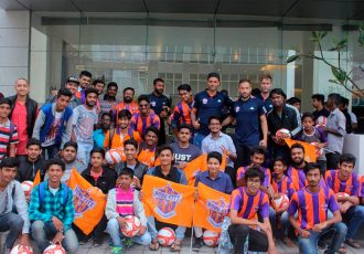 Orange Army fans welcome FC Pune City players amidst boisterous cheering