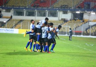 India U-16 players celebrating a goal.