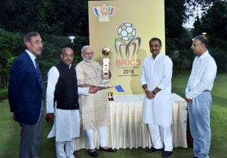 Prime Minister Narendra Modi unveils BRICS U-17 Football Tournament trophy