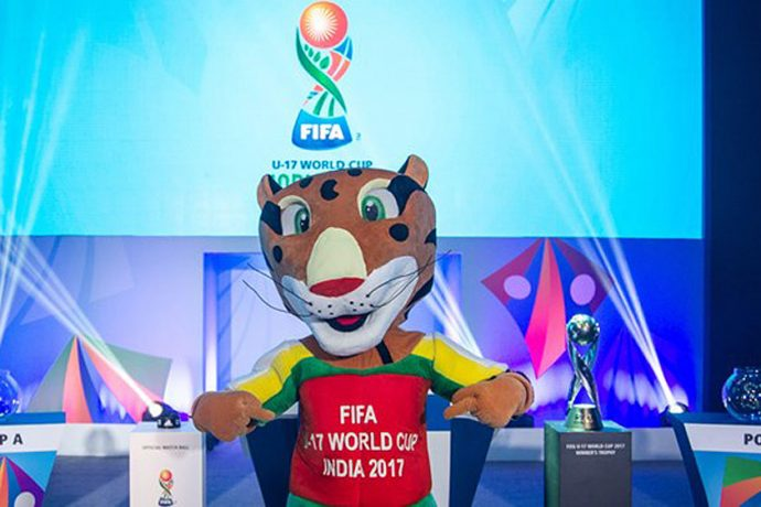 FIFA U-17 World Cup India 2017 mascot Kheleo posing with the FIFA U-17 World Cup trophy at the Offical Draw in Mumbai (Photo courtesy: FIFA U-17 World Cup LOC)