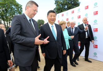 President of the German Football Association (DFB) Reinhard Grindel, Chinese President Xi Jinping, German Chancellor Angela Merkel (CDU) and the President of the German Football League (DFL) Reinhard Rauball (L-R) attend the Chinese German football summer camp at Stadion am Wurfplatz on July 5, 2017 in Berlin, Germany. (Photo by Matthias Kern/Bongarts/Getty Images)