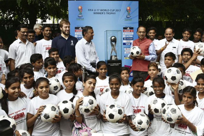 The Minister of State for Youth Affairs and Sports (I/C), Water Resources, River Development and Ganga Rejuvenation, Shri Vijay Goel received the FIFA U 17 World Cup trophy before its Journey to other venues of FIFA World Cup, in New Delhi on August 25, 2017. (Photo courtesy: Press Information Bureau, Government of India)