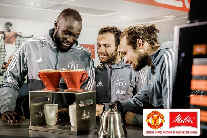 Romelu Lukaku, Juan Mata and Daley Blind prepare Melitta hand-filtered coffee. (Photo courtesy: Melitta)