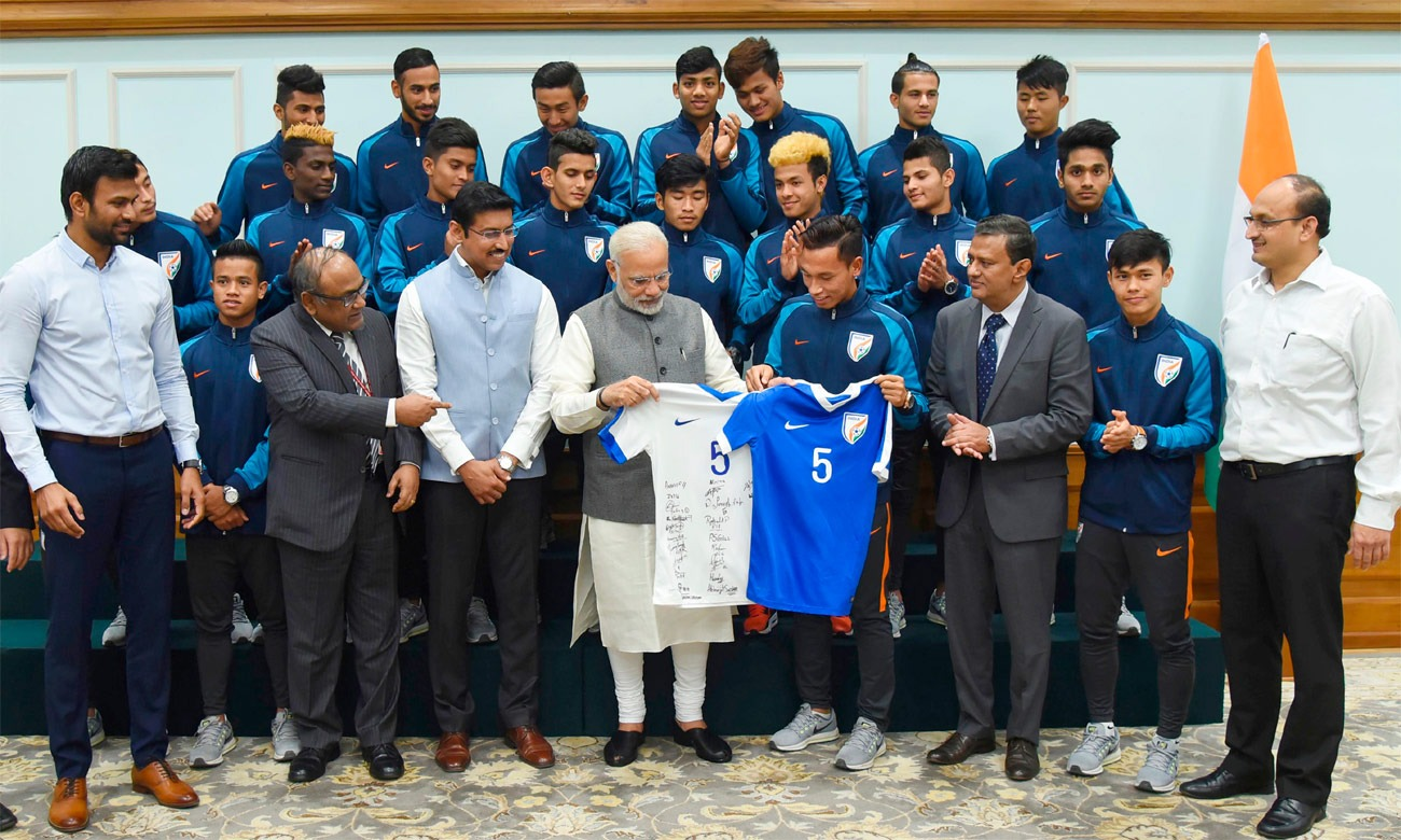 The Prime Minister, Shri Narendra Modi in a group photograph with the Indian U-17 national team that participated in FIFA U-17 World Cup India 2017, in New Delhi on November 10, 2017. (Photo courtesy: Press Information Bureau, Government of India)