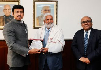 The Minister of State for Youth Affairs and Sports (I/C) and Information & Broadcasting, Col. Rajyavardhan Rathore felicitating the Football Legend Gurdev Singh, in New Delhi on December 12, 2017. The Secretary (Sports) & DG, Sports Authority of India (SAI), Shri Rahul Prasad Bhatnagar is also seen. (Press Information Bureau, Government of India)