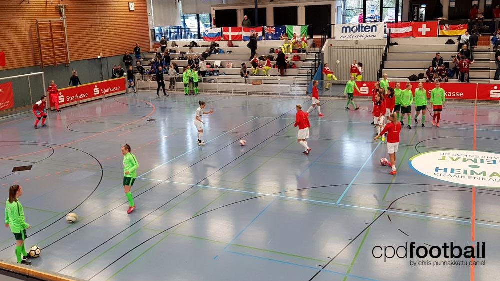 """Day 1: Werder Bremen and SGS Essen player before the Werder Bremen squad warmin up at """"Weltklasse 2018"""" - 38. Internationales Frauenfußball-Hallenturnier des TuS Jöllenbeck"""
