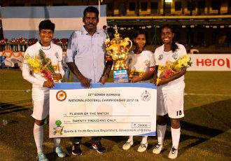 Tamil Nadu Women's Team Head Coach M. Muruhuvendan with three of his players. (Photo courtesy: AIFF Media)