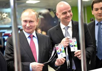 The President of the Russian Federation Vladimir Putin and FIFA President Gianni Infantino with the 2018 FIFA World Cup FAN ID. (Photo courtesy: kremlin.ru)