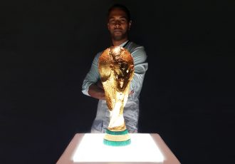 Chris Punnakkattu Daniel with the FIFA World Cup trophy. (© CPD Football)
