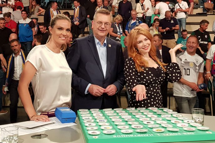 Julia Scharf, Reinhard Grindel and Palina Rojinski during the DFB-Pokal 2018/19 Round 1 draw ceremony at the Deutsches Fußballmuseum (German Football Museum) in Dortmund on June 8, 2018. (© CPD Football)