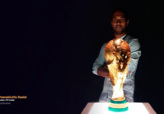 Chris Punnakkattu Daniel (CPD Football) with the FIFA World Cup trophy. (© CPD Football)