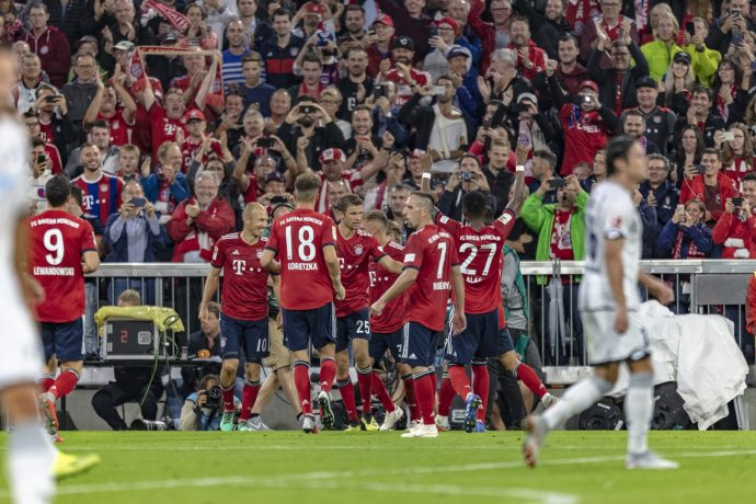 FC Bayern Munich players celebrating at the Allianz Arena in Munich, Germany. (Photo courtesy: Siemens / The Economist Group)