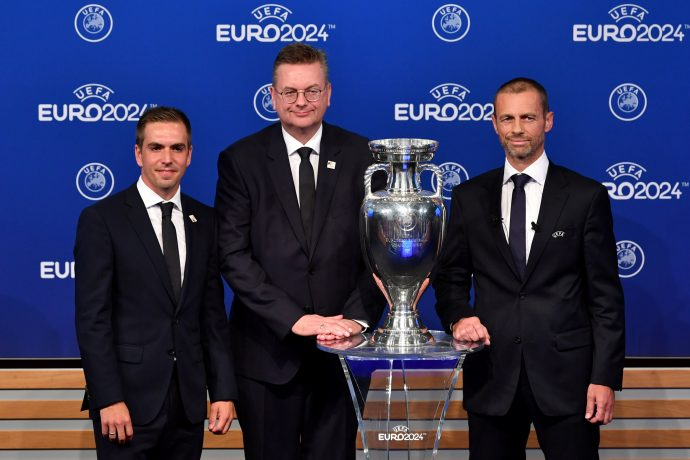 Bid ambassador Philipp Lahm, DFB President Reinhart Grindel and UEFA President Aleksander Ceferin on stage following the announcement of Germany as the bid winners during the UEFA EURO 2024 host city announcement at the UEFA headquarters, The House of European Football on September 27, 2018 in Nyon, Switzerland. (Photo by Harold Cunningham - UEFA/UEFA via Getty Images)