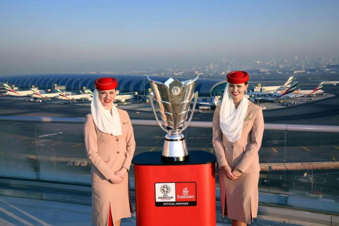 Emirates cabin crew members present the AFC Asian Cup trophy at the Dubai International Airport. (Photo courtesy: Emirates)