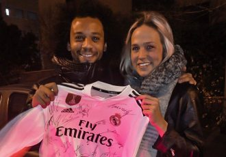 Brazil and Real Madrid superstar Marcelo and Bella Linden with the original autographed Real Madrid jersey. (Photo courtesy: Bella Linden)