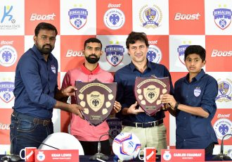 Bengaluru FC Head of Operations Srinivas Murthy, first team player Kean Lewis, head coach Carles Cuadrat and U-13 player Gautam Rajesh at the BOOST BFC Inter-School Soccer Shield launch. (Photo courtesy: Bengaluru FC)