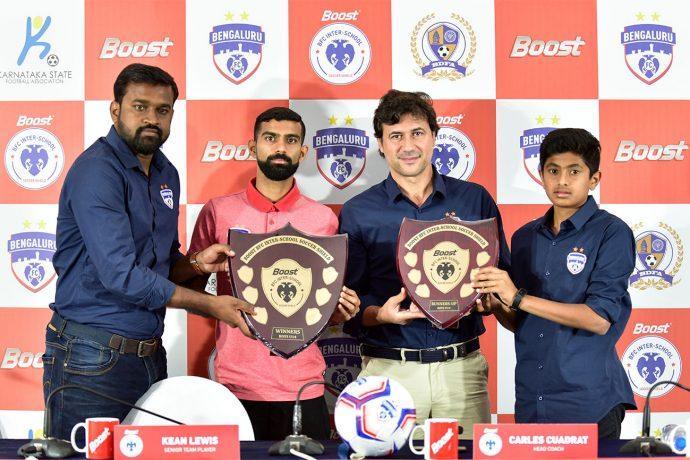 Bengaluru FC Head of Operations Srinivas Murthy, first team player Kean Lewis, head coach Carles Cuadrat and U-13 player Gautam Rajesh at the BOOST BFC Inter-School Soccer Shield launch. (Photo courtesy: Bengaluru FC)