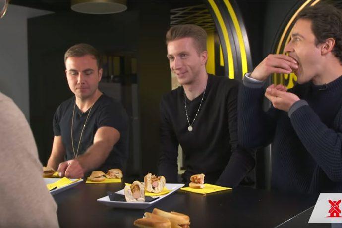 Borussia Dortmund stars Mario Götze, Marco Reus and Thomas Delaney during the Rügenwalder Mühle veggie taste test. (Photo courtesy: Screenshot - Borussia Dortmund YouTube video)