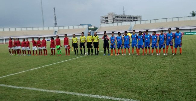 The women's national teams of Indonesia (red) and India (blue) ahead of their international friendly match. (Photo courtesy: AIFF Media)