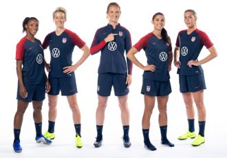 U.S. Women's National Team members (from left to right) Crystal Dunn, Megan Rapinoe, Sam Mewis, Alex Morgan and Allie Long show off the team's new training jerseys. (Photo courtesy: Volkswagen)
