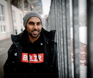 Photo shooting at the SchücoArena in Bielefeld: Chris Punnakkattu Daniel (CPD Football) wearing a hoodie by football streetwear fashion label BOLZR. (© Oliver Hugo - www.oliver-hugo.de)