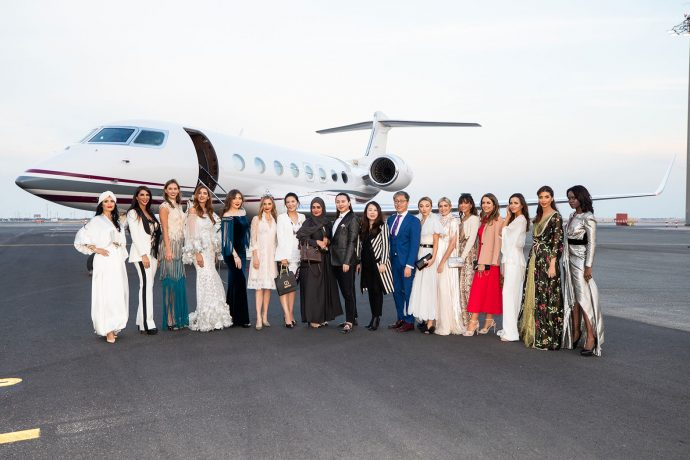 Fashion models pose in front of Qatar Airways' state-of-the-art G650 private jet as part of an exclusive fashion show on board. (Photo courtesy: Qatar Airways)