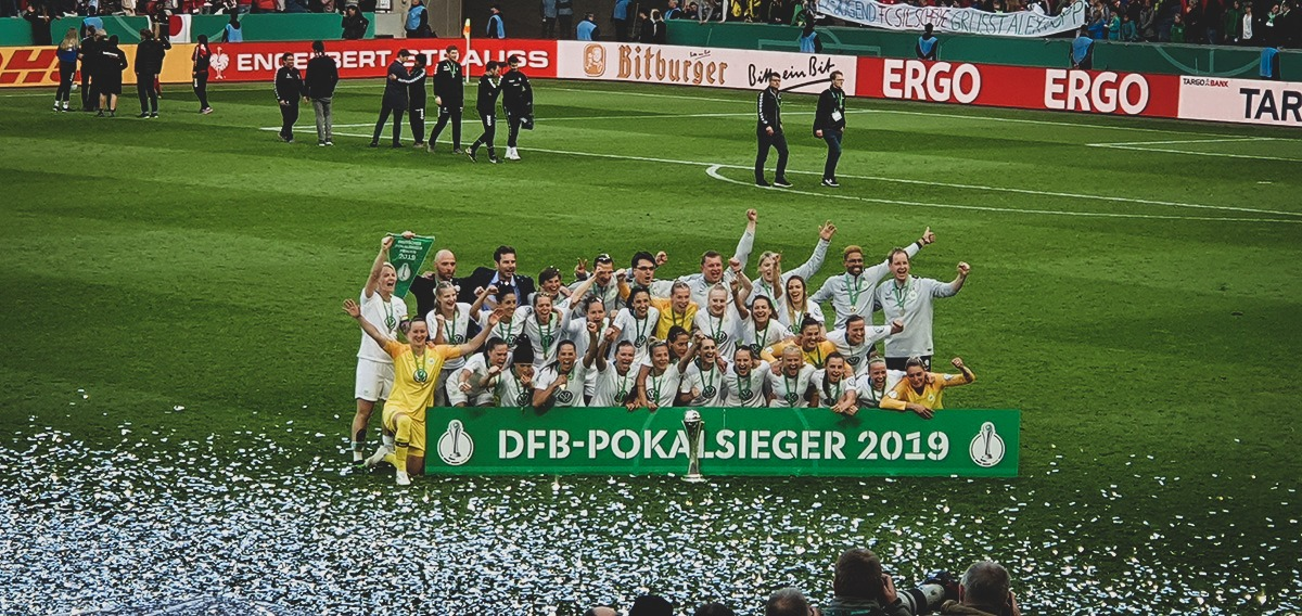 VfL Wolfsburg players celebrating their fifth consecutive DFB-Pokal der Frauen (German Women's Cup) title. (© CPD Football)