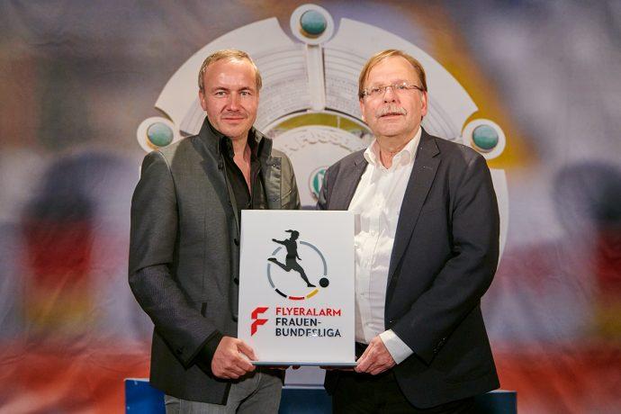 FLYERALARM CEO Thorsten Fischer and DFB Vice President Dr. Rainer Koch present the new logo of the FLYERALARM Frauen-Bundesliga (Women's Bundesliga). (Photo courtesy: FLYERALARM)