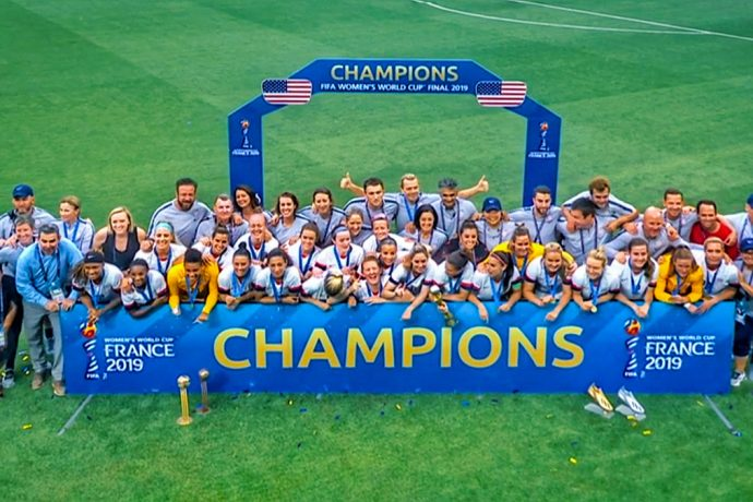 United States players and officials celebreating their fourth FIFA Women's World Cup title.