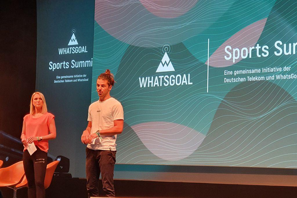 Ruth Hofmann (Sport1) and Riccardo Basile (Sky Sports) presenting the WhatsGoal Sports Summit 2019 in Düsseldorf, Germany. (© CPD Football)