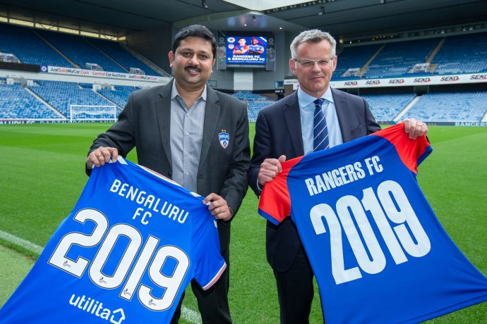 Bengaluru FC CEO, Mandar Tamhane exchanges club shirts with Rangers FC Managing Director, Stewart Robertson at the Ibrox Stadium in Glasgow after the clubs announced a partnership, on Friday. (Photo courtesy: Bengaluru FC)