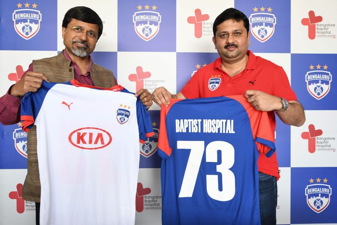 Dr. Naveen Thomas, CEO & Director of Baptist Hospital, and Bengaluru FC CEO Mandar Tamhane at the signing of the MoU at the Bengaluru Football Stadium. (Photo courtesy: Bengaluru FC)