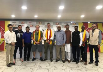 East Bengal and Manchester United officials at the sidelines of a meeting in Kolkata.