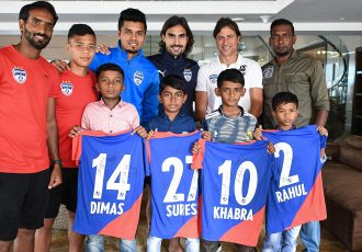 Bengaluru FC head coach Carles Cuadrat and some his players with the children from the 'viral free-kick video' at their team hotel in Kochi. (Photo courtesy: Bengaluru FC)