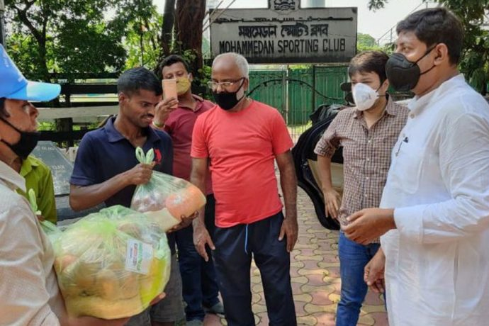 Mohammedan Sporting Club officials distributing food aid bags to help the groundsmen of Kolkata Maidan. (Photo courtesy: Mohammedan Sporting Club)